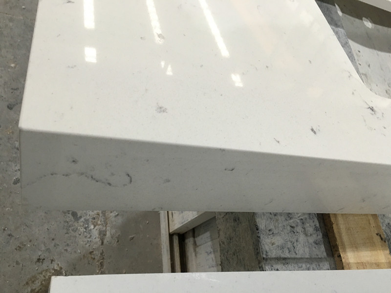 Hospitality quartz countertops with seamless miter joint for Seamless quartz countertops
